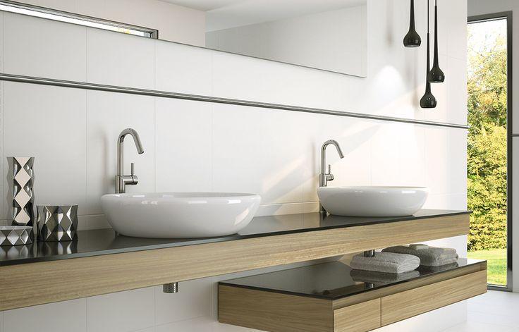 Revestimientos blancos que dotarán a tu baño de un ambiente de paz y limpieza.