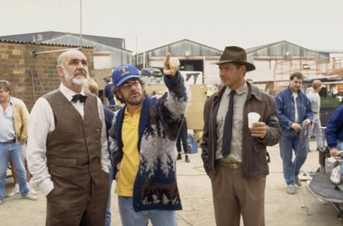 Sean Connery and Harrison Ford with Steven Spielberg on the set of Indiana Jones and the Last Crusade (1989). #ConneryDay