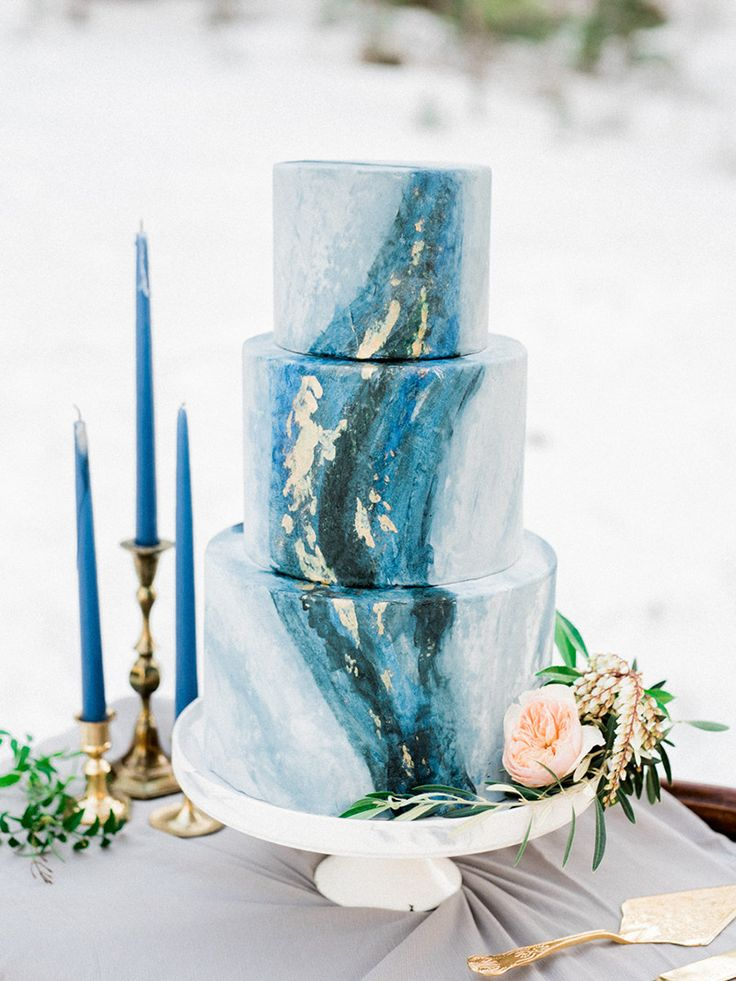 Blue marble wedding cake with gold flake details