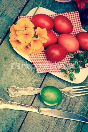 Beautiful Easter painted eggs on the wooden rustic table