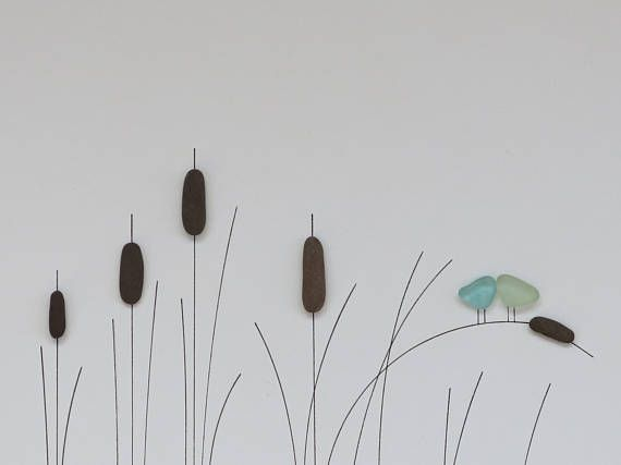 Pebble Art Love Birds & Cattails Made of sea glass and beach pebbles! Comes in a black wooden frame with glass and is ready for wall or tabletop display! Frame measures about 11x9 and is matted to 6.5x4.5 Thanks so much for looking!:)