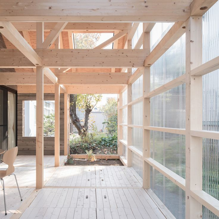 Timber-framed home by Yoshichika Takagi features attic bedrooms and a translucent sunroom