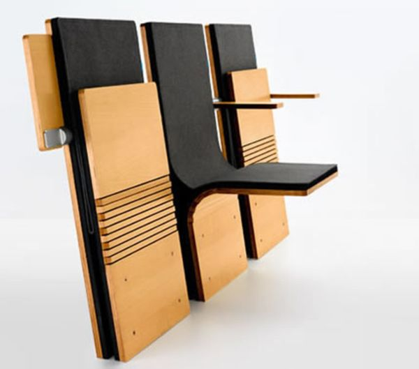 Auditorium seating that is only 4 inches when folded up.  Allows for maximum seating within a theater or auditorium setting.