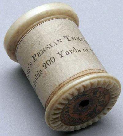Old Ivory Thread Spool.