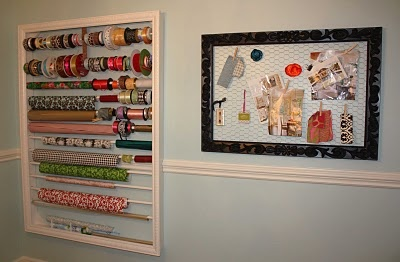 DIY wrapping paper / ribbon holder & an old, empty frame into an inspiration board using chicken wire…  >>I told you I was gonna do it: A Crafty Room Reveal