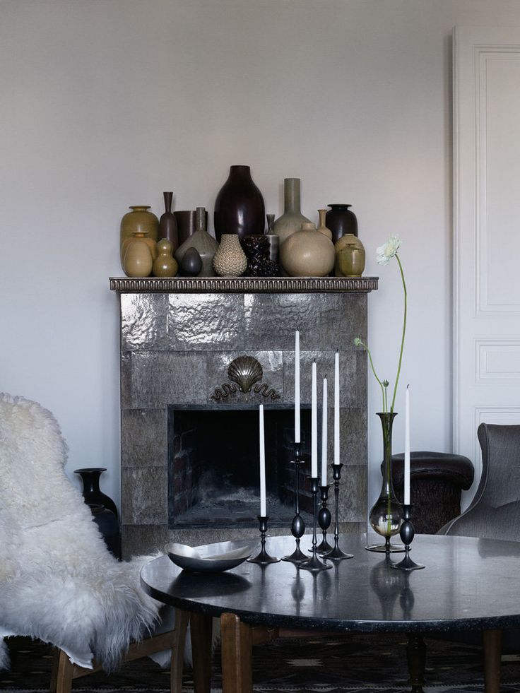 """""""The vases on top of the tiled fireplace are the work of Modernist ceramists Axel Salto and Berndt Friberg among others."""""""