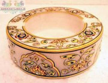 Bring grandeur to the room with this ornately hand painted Ashtray with yellow ,black bordered and topped of with a lovely 22 carat gold leaf work. The designs are so painted to look like various jewellery piece wrapped on the hookah that is crafted from pure white Rajasthan marble.