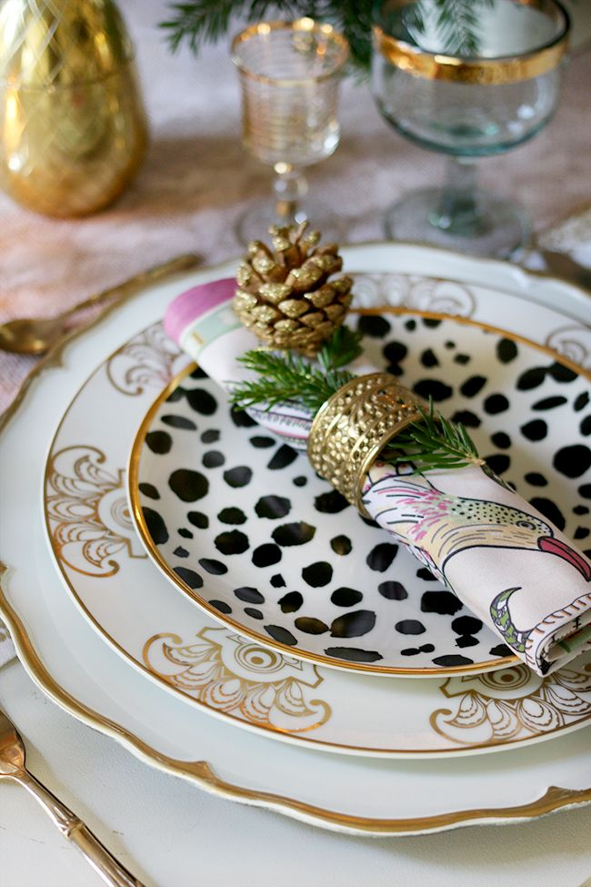 How to create a glam Christmas table setting on a budget with layered plates in gold black and white