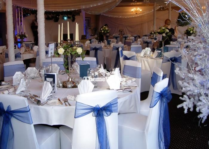 White and blue chair covers and our Winter Wonderland themed wedding