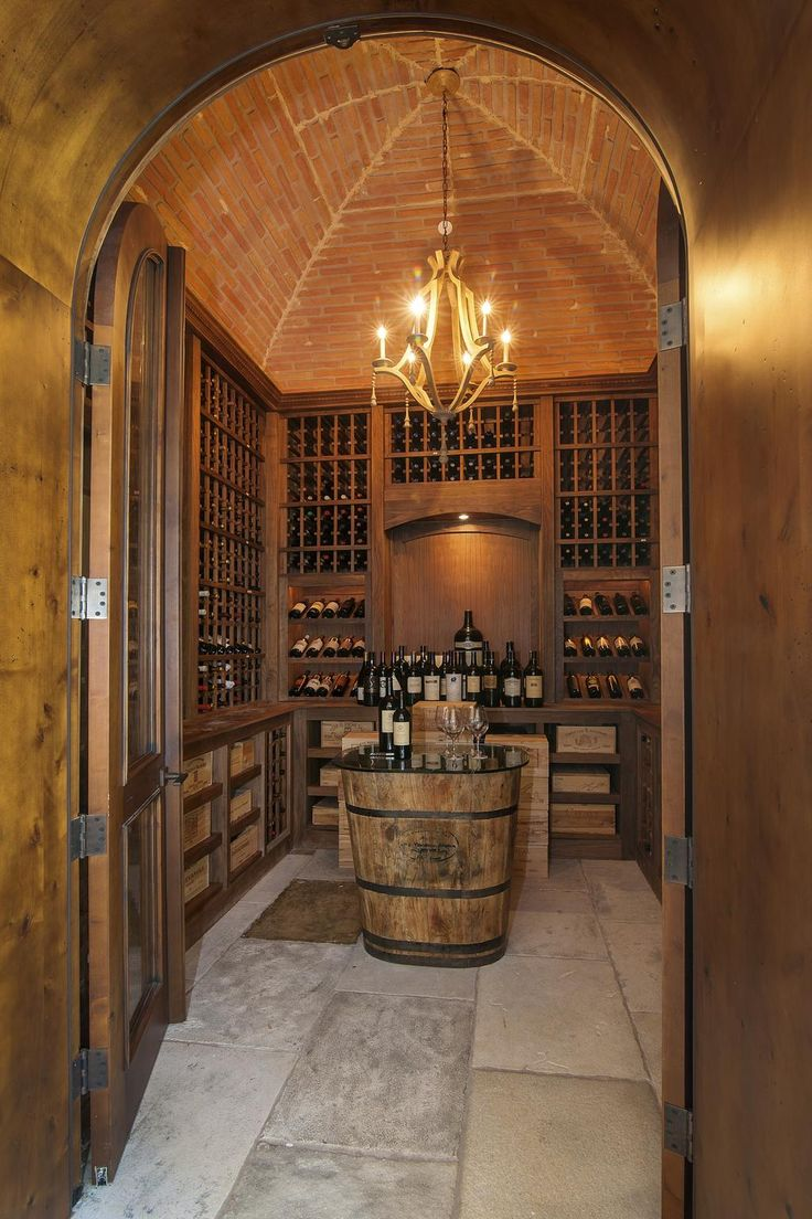 Dining room wine vault the temperature controlled wine for Home wine cellar kits