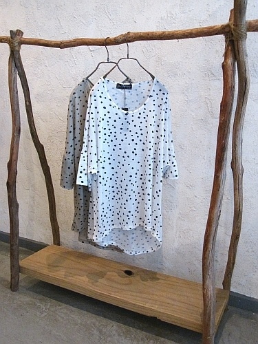 clothing rack made from branches  Wouldn't this be great for a rustic utility area?