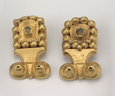 Belt-Buckles Gold and glass; case, forged, with false granulation. L. 4.5 cm Era of the Avars' and Khazars' State. 7th century Pereshchepina Complex, near Poltava, the Village of Malaya Pereshchepina Russia (now Ukraine) Source of Entry:   Imperial Archaeological Commission, St Petersburg (acquired from B. I. Khanenko). 1914