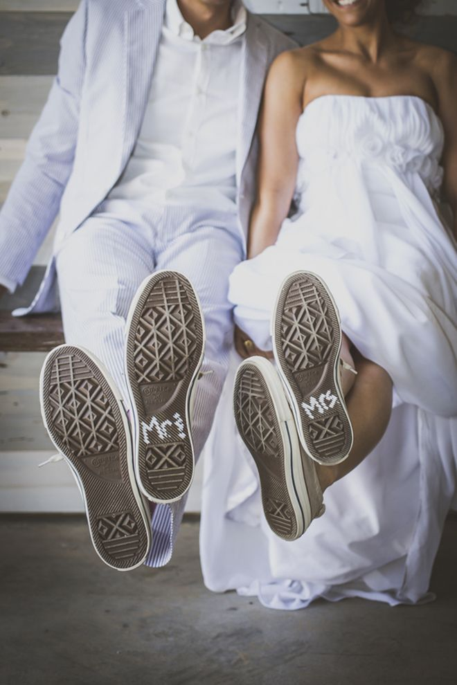The bride and groom painted the bottom of their wedding Converse to read Mr and Mrs, so cute!