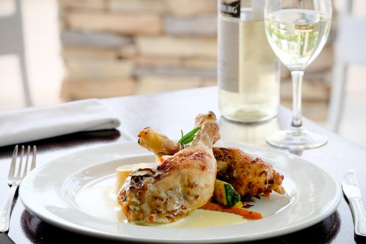 Golden Roasted Chicken Leg quarter stuffed with Peppadews, Capers and Cheddar Cheese served with a Rosemary Cream reduction