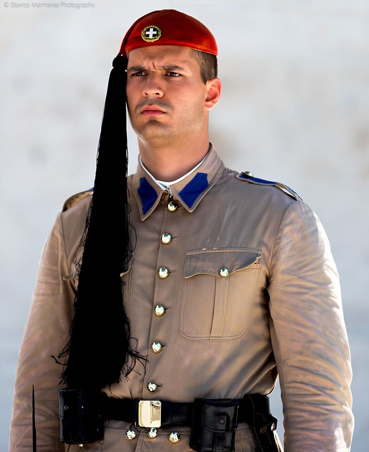 The Evzones - The Evzones, or Evzoni is the name of several historical elite light infantry and mountain units of the Greek Army. Today, it refers to the members of the Presidential Guard, an elite ceremonial unit that guards the Greek Tomb of the Unknown Soldier, the Presidential Mansion and the gate of Evzones camp in Athens.