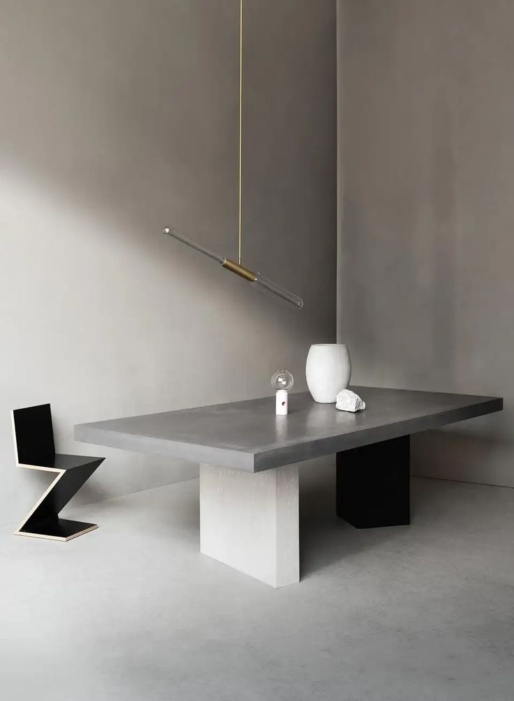 This table embodies the brand philosophy of discovering physical and stylistic lightness in a material that is traditionally regarded as heavy and rough. Fashioned of high-performance concrete, the rectangular top is supported by two asymmetric legs Furniture, Concrete Dining Table, Concrete Coffee Table, Dining Table, Furniture Trends, Concrete Furniture, Solid Wood Tv Stand, Circular Dining Table, Feminine Living Room