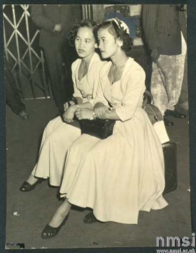 Mrs Louise Pusey and Mrs Violet Johnston waiting for friends to collect them at Waterloo Station, London, taken by Lauder for the Daily Herald newspaper on 22 September, 1954. The two Jamaican women came to London in 1954.
