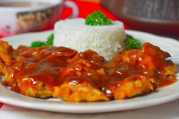 Pork in batter with sweet and sour sauce.
