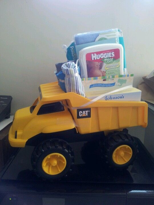 Picture #1 of Baby Boy shower gift i made; a CAT toy dump truck, diapers, wipes, facecloths, travel baby accessories, and outfits