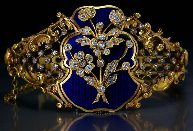 A FABERGE gold bangle bracelet influenced by French Louis XV style of the mid 18th century    made in St. Petersburg between 1899 and 1903 by Faberge's principal jeweler August Holmstrom.