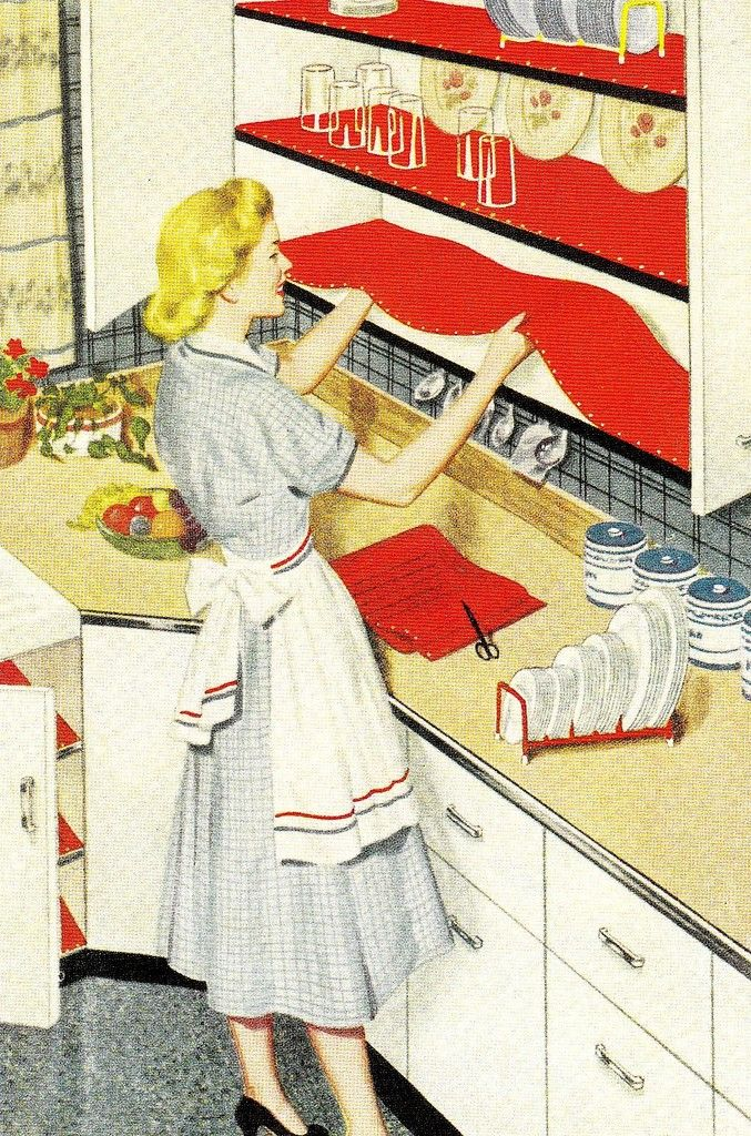 Fifties housewife beautifying her shelves.  I actually have a lot of this vintage shelving paper - it's fun stuff!