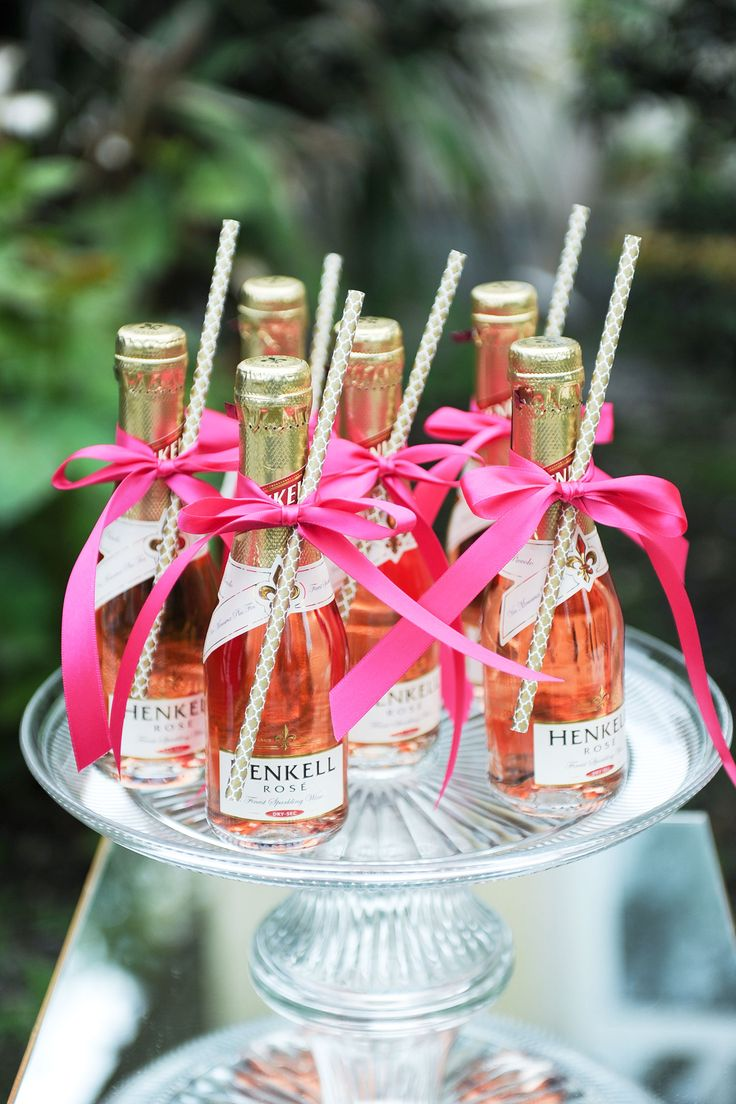 Mini champagne bottles with pink bows and straws - perfect for a party