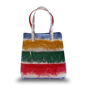 """'""""Riedizioni"""" Basket Bag multicolor fringe in polyurethane'  Riedizioni is the name for a series of personal and products for the house made from industrial waste materials. Another word for this is recycling.  The Milan-based designer is known for fixing fabric remnants in resin for her Riedizioni line of bags and shades. Her mantra is a simple one: """"I love waste""""."""