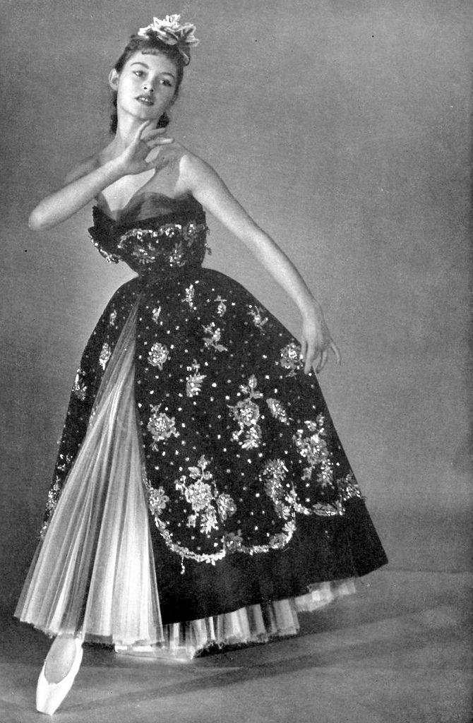Brigitte Bardot models a Christian Dior gown of gilt embroidered velvet over tulle