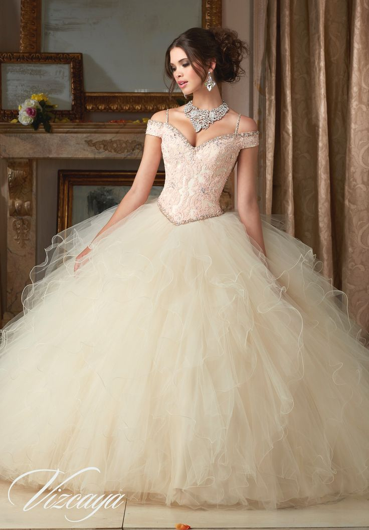 Elegant and timeless, Mori Lee Vizcaya Quinceanera Dress Style 89102 is a must-have ball gown for any girl's Sweet 15 party. Made out of lace and tulle, this Quince dress features a off-the-shoulder c