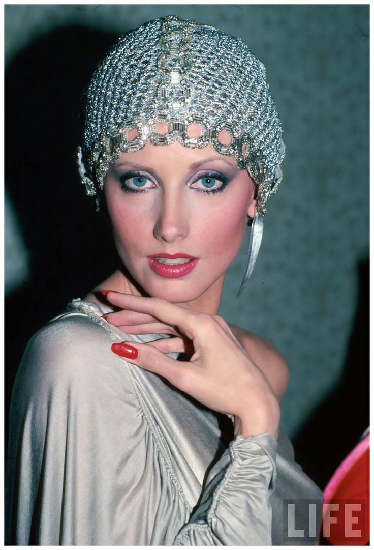 Actress Morgan Fairchild wearing mesh hat 1982
