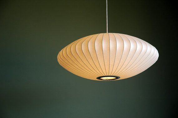 This is the original George Nelson Large saucer pendant light, designed by George for the Howard Miller Company in the mid 50s. This piece is a