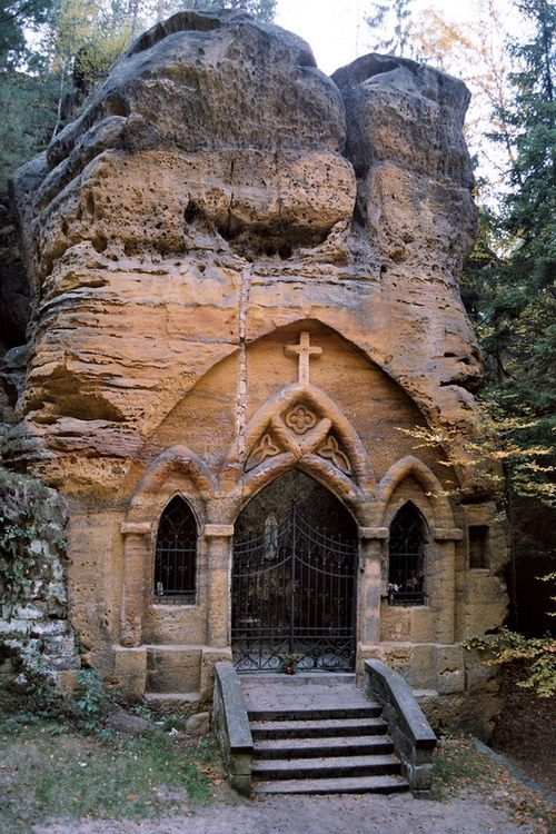 Rock chapel, a place of pilgrimage carved from sandstone in the Valley of Modlivy dul, Svojkov, Czech Republic.