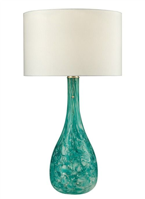 """Seafoam green shades are hand blown into a thick and heavy blown glass lamp base by a skilled artisan, making each of these 29"""" tall lamps unique."""