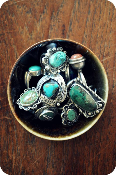 A bowl of Turquoise rings.