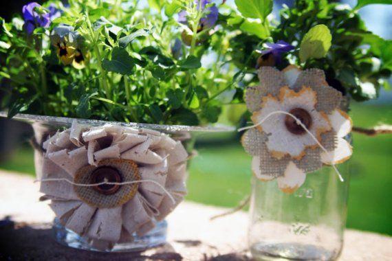 Burlap/raw cotton flowers around jars.