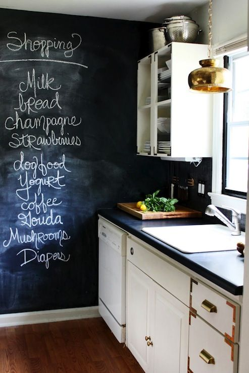 The Hunted Interior - kitchens - vintage kitchen, chalkboard walls, kitchen chalkboard, brass pendant, kitchen pendant, kitchen lighting, open shelves, brass pulls, brass hardware, kitchen hardwood floors, inset cabinets, white inset cabinets, black countertops,