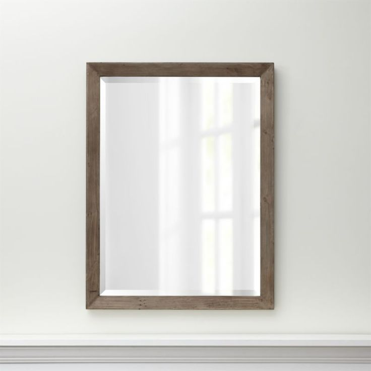 Shop Morris Ash Grey Wall Mirror.   Scaled large for maximum impact in any room, the beveled glass mirror is presented in a simple frame.  The Morris Ash Grey Wall Mirror is a Crate and Barrel exclusive.