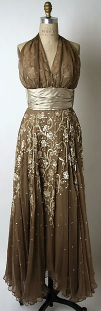 Silver and brown evening gown, 1953. Leslie Morris designer, American. Silk and plastic. Plunging necklines on gowns were popular in this time period.