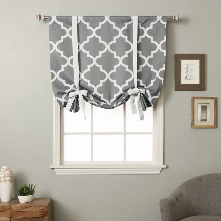 Add a touch of contemporary style to any space with the Aurora Home 63-inch Moroccan Print Room Darkening Tie-up Window Shade. This shade features a Moroccan inspired trellis pattern in white and grey that you will be sure to love.