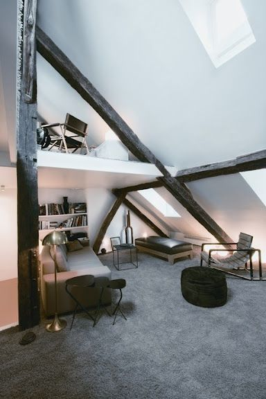 love the shape of this room!!!  The beams also make it as well!!