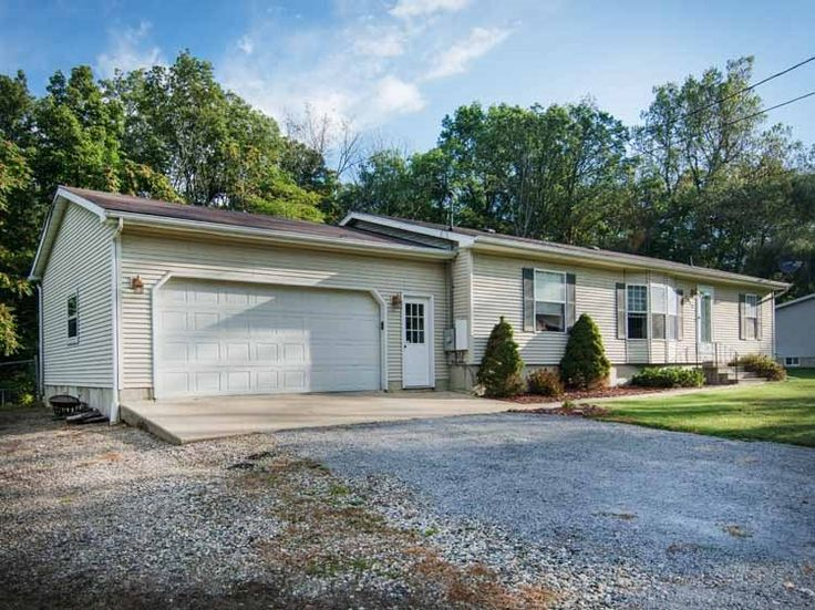 Modular ranch home with attached garage. Remodeling