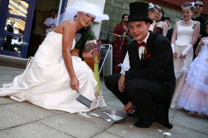 At the beginning of the Czech wedding reception, a plate is broken at the feet of the bride and groom and they must sweep the chips together. This tradition has its roots in two superstitions; that chips bring happiness and the newlyweds show a will to cooperate by jointly sweeping the chips away and their marriage will therefore be harmonious.