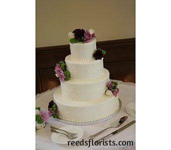 Fresh flowers ensure that our bride's cake co-ordinates with her colour scheme perfectly. reedsflorists.com