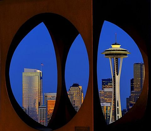 View through steel sculpture by Doris Chase, night view, skyline of Seattle financial district with Space Needle, Columbia Center, formerly Bank of America Tower, Two Union Square Tower, Municipal Tower, formerly Key Tower, US Bank Center,