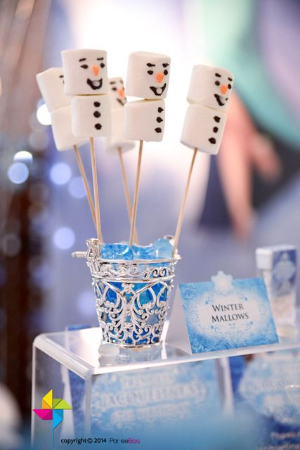 Cute snowman pops at a Frozen girl Birthday Party!  See more party ideas at CatchMyParty.com!