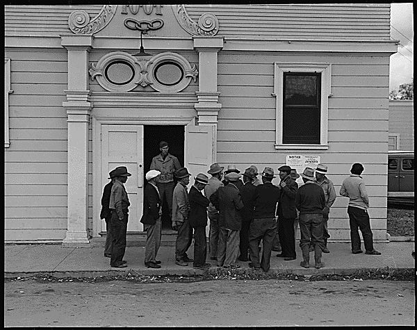 537773: Byron, California. Field laborers of Japanese ancestry from a large delta ranch have assembled at Wartime Civil Control Administration station to receive instructions for evacuation which is to be effective in three days under Civilian Exclusion Order Number 24. They are arguing together about whether or not they should return to the ranch to work for the remaining five days or whether they shall spend that time on their personal affairs.
