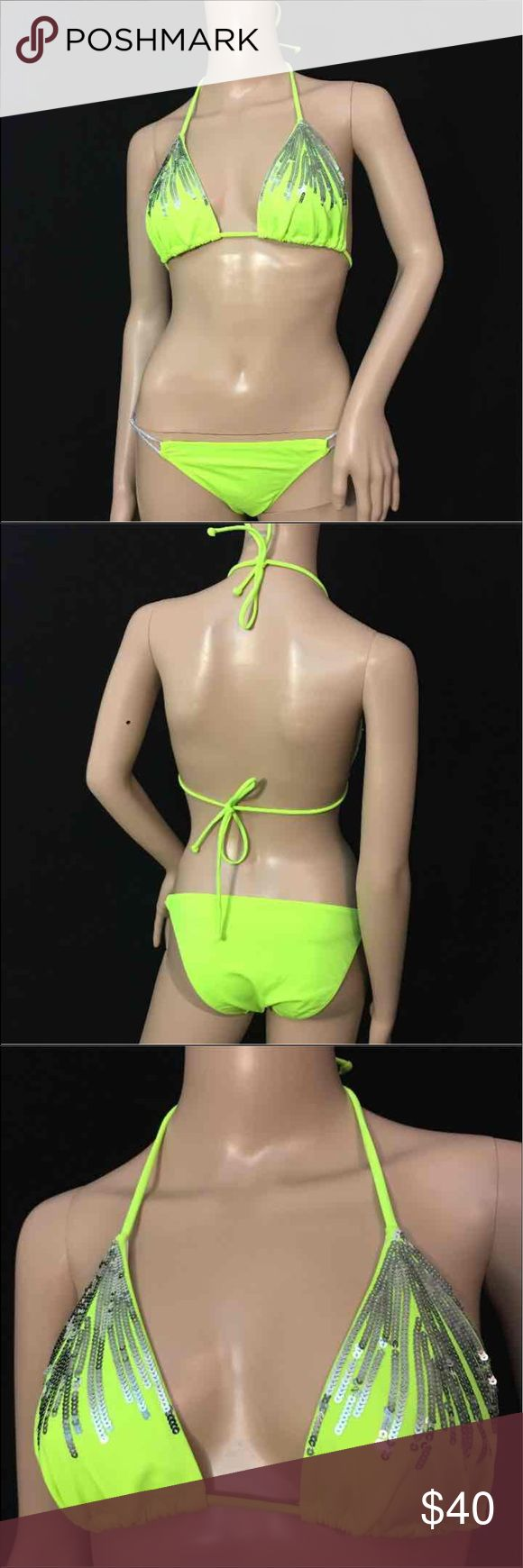 Victoria's Secret Neon Yellow w/ Silver Sequins Super sexy Victoria's Secret Neon yellow with silver sequin detail • Tags have been cut out but both top and bottoms are a size medium • Suit is in like new condition and was never worn • Bottoms have silver interlocking straps and top is a triangle style • suit is excellent shape and no flaws Victoria's Secret Swim Bikinis