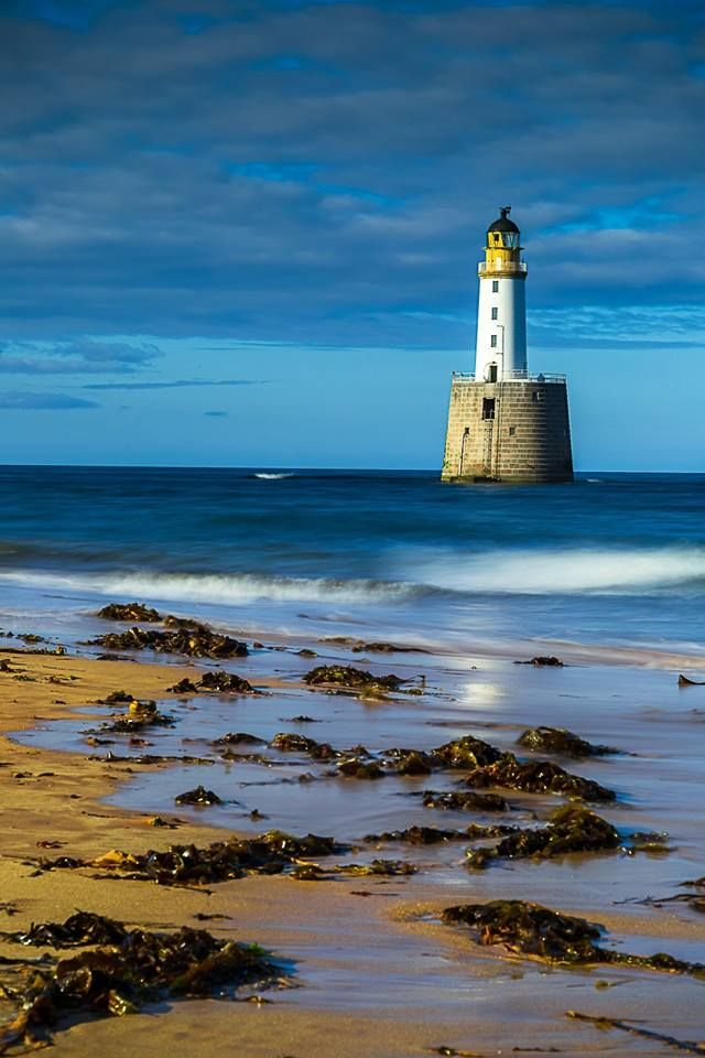 Rattray Head Lighthouse amidst the blue.