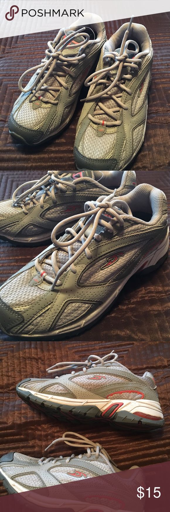 Gray athletic shoe with Dr. Scholl's interior. NWOT Athletic workout tennis shoe with Dr. Scholl's interior. Never worn NWOT. Gray with peach/orange colored accents. Shoes Athletic Shoes
