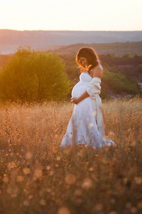 who doesn't love the idea of a white dress in a field of wild flowers